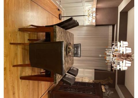 GRANITE TABLE AND 6 LEATHER CHAIRS